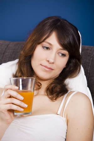 Beautiful and healthy young woman drinking a orange juice Stock Photo - 9111970