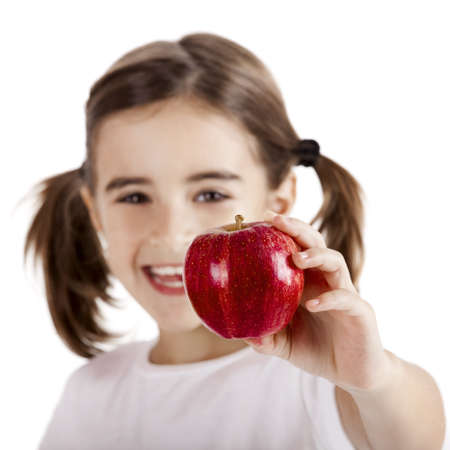 hungry children: Healthy little girl holding and showing a red apple Stock Photo