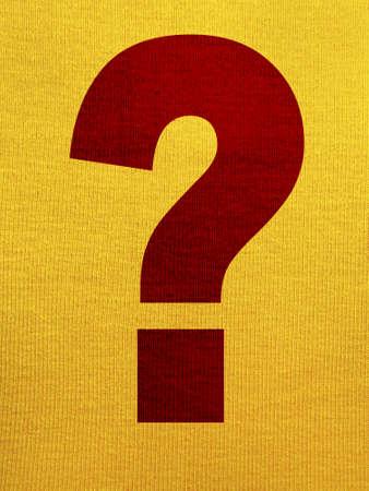 point d interrogation: Point d'interrogation sur un fond de tissu jaune Banque d'images