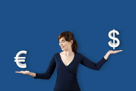 Woman making a scale with her arms and checking Euro versus Dolar photo