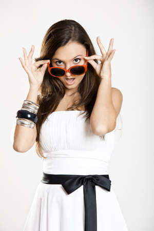astonish: Beautiful young woman wearing sunglasses and with a astonish expression