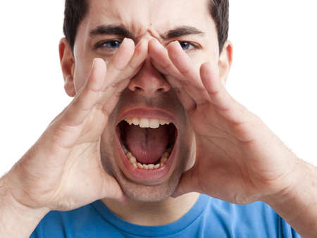 shout: Portrait of a young man shouting loud with hands on the mouth, isolated on white background Stock Photo