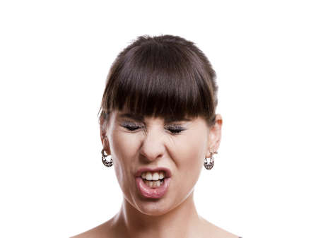 constipated: Close-up portrait of a funny woman with a upset expression against white background