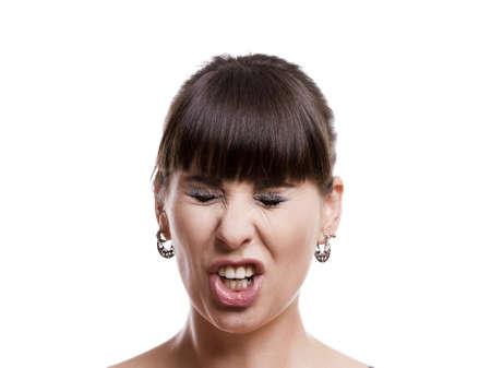 constipated: Primer plano retrato de una mujer divertida con una expresi�n de malestar sobre fondo blanco Foto de archivo