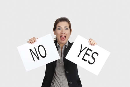 Business young woman trying to make a decision between Yes or No choice Stock Photo - 9420886