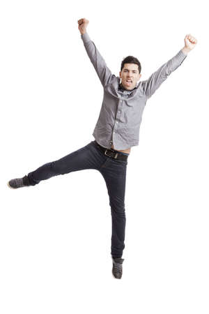 arms open: Happy young man with arms up isolated on a white background  Stock Photo