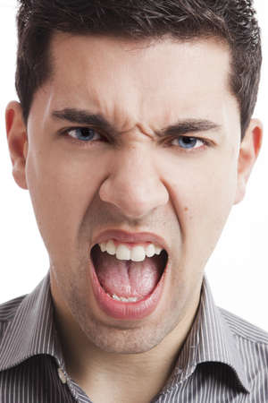 Portrait of a angry young man yelling, isolated on white background photo