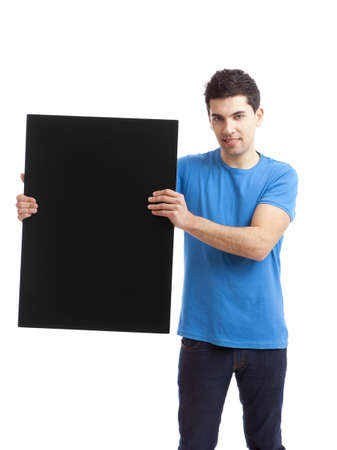 Portrait of a young man showing an empty black billboard on white background  photo