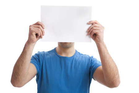 presenting: Young guy holding a blank bill board over face isolated on white  Stock Photo