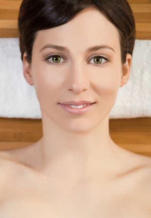 Portrait of beautiful young woman on a spa relaxed after a\ spa treatment
