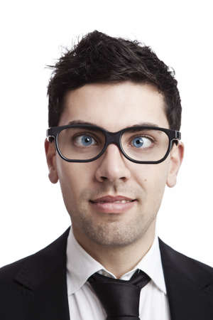 goofy: Funny portrait of a young businessman with crooked eyes wearing nerd glasses Stock Photo