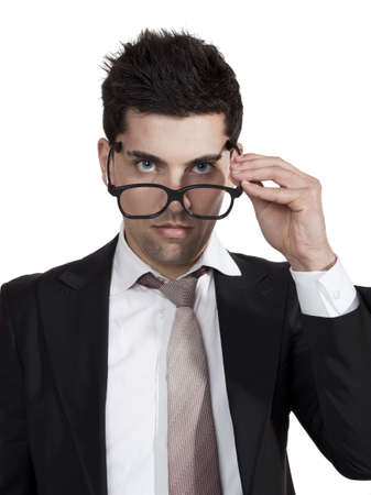 Portrait of a young businessman taking of is nerd glasses photo