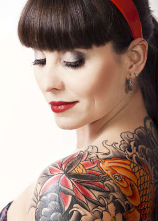 tattoo face: Portrait of a beautiful young woman with a tattoo on the backs