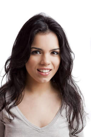 Portrait of a beautiful young woman smiling, isolated over white background Stock Photo - 9645951