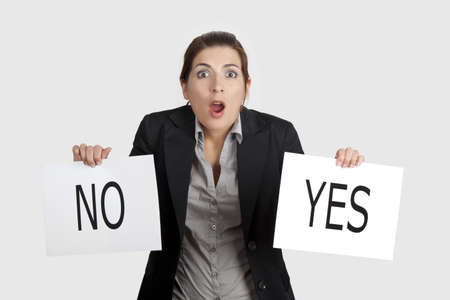 voting decision: Business young woman trying to make a decision between Yes or No choice Stock Photo