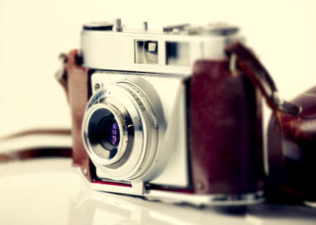 Old fashioned photography camera isolated over a white background photo