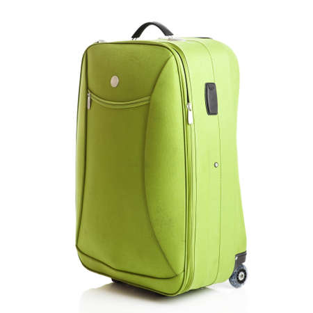 Green suitcase isolated over a white background photo