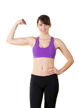 Beautiful and athletic young woman posing over a white background Stock Photo - 10017587