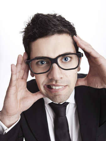 Funny portrait of a young businessman with a nerd glasses photo
