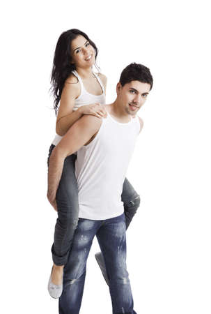 Beautiful and happy young couple standing over a white background Stock Photo - 10017625