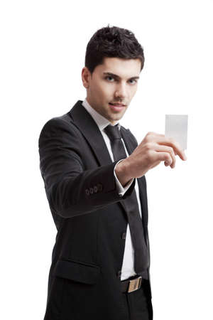 Young businessman holding a personal card on the hand, isolated over a white background  photo