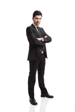 businessman standing: Studio portrait of a young businessman isolated over a white background