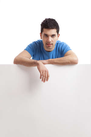 Portrait of a young man showing an empty billboard on white background  photo