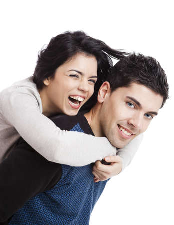 Attractive and happy young couple isolated over a white background Stock fotó