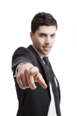 cool attitude: Young businessman pointing to you, isolated over a white background
