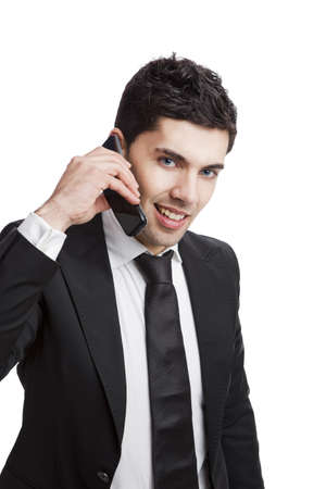 Businessman talking at cellphone, isolated over a white background  photo