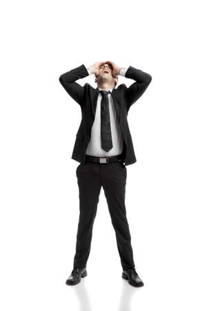 unsatisfied: Young businessman worried with a bad business, isolated over a white background