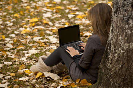 Beautiful woman working with a laptop in outdoor Stock Photo - 10945270