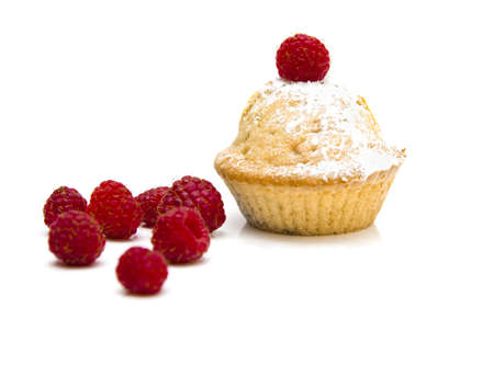 fruitcake: Muffins with raspberries isolated over a white background