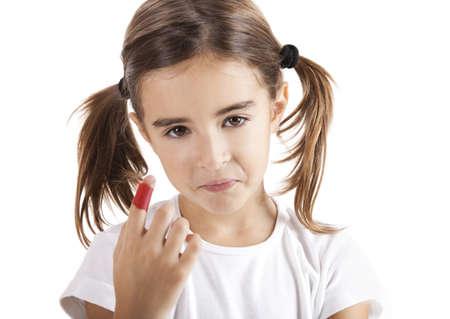 adhesive bandage: Little girl with a injured finger, isolated on white Stock Photo