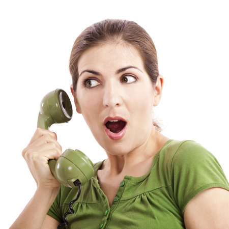 astonished: Beautiful woman at phone astonished with something