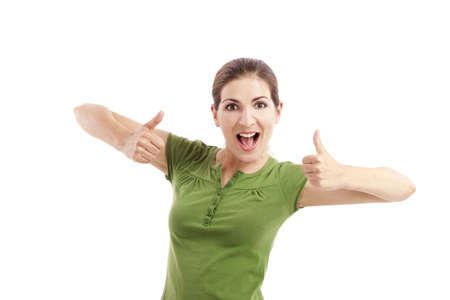 spokojený: Krásná dívka s palce nahoru, izolované proti bílému pozadí Reklamní fotografie