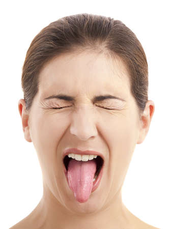 tongue out: Close-up portrait of a funny woman pulling tongue out, isolated on white background Stock Photo