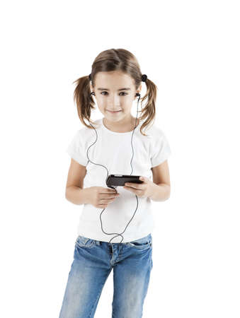 Little girl listen music with a MP3 player, isolated on white photo