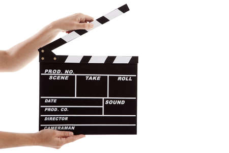 take action: Female hands holding a clapboard, isolated on white