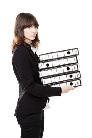 Business woman full of work holding a pile of folders, isolated on white background photo
