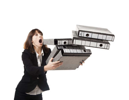 stumble: Woman in the office stumbling with a pile of folders in the hands, isolated on white Stock Photo