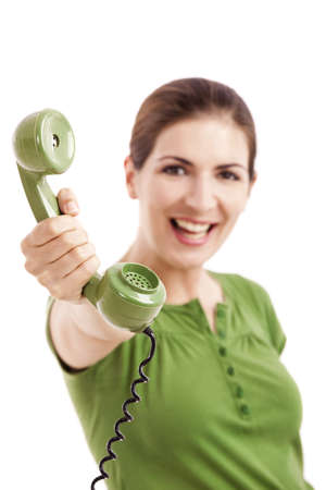 Beautiful woman holding a vintage phone, isolated on white Stock Photo - 12165427