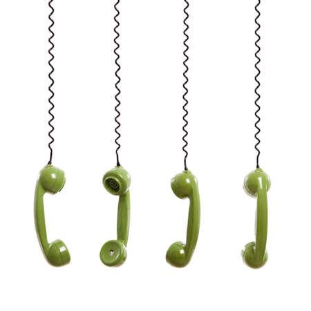 telefono antico: Pezzo del portatile da un vecchio telefono sospeso dal cavo telefonico, isolato su sfondo bianco Archivio Fotografico