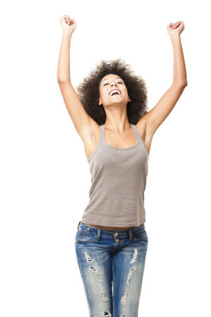 Happy Afro-American young woman isolated on white with arms on the air Stock Photo - 12165423