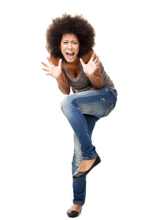 Horrified young woman in panic yelling, isolated on white photo