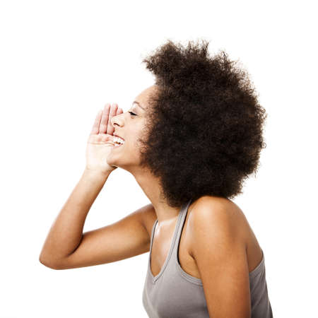 Profile of a young Afro-American woman calling someone, isolated on white photo