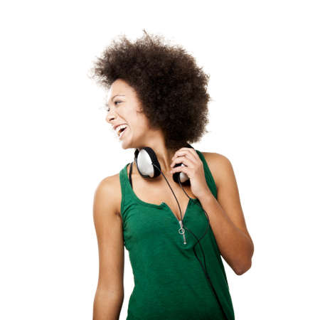 Beautiful happy woman laughing with headphones on the neck, isolated on white background photo