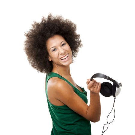 Beautiful young woman with headphones, isolated on white background photo