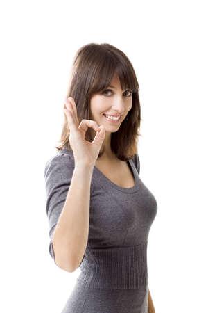 coincidir: Hermosa mujer señalando un signo excelente trabajo aislado sobre fondo blanco Foto de archivo
