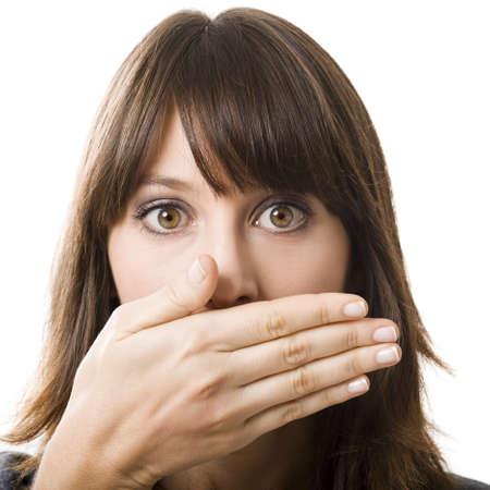 quiet adult: Giovane e bella donna che copre il viso con la mano, isolato su uno sfondo bianco